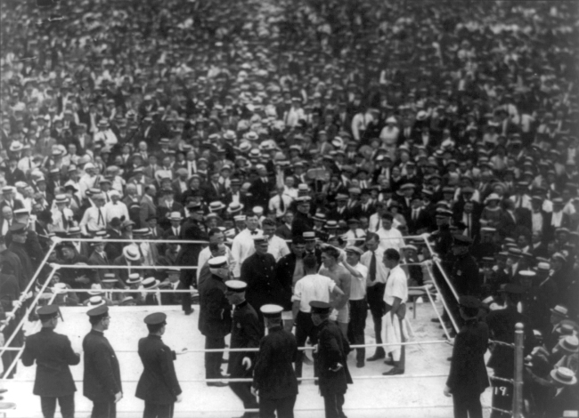 A fight involving one of the most famous and successful boxers of all time, Jack Dempsey. http://en.wikipedia.org/wiki/File:Jack_Dempsey_v_Georges_Carpentier_cph.3b35134.jpg