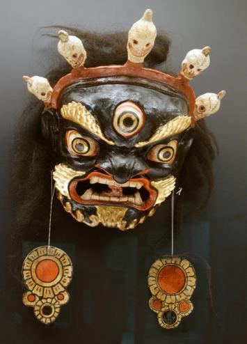 Tibetan Cham dance mask, depicting Mahakala, the protector of Buddhist teachings and skull popsicles. Now at Shanghai Museum, Shanghai, China. (e)